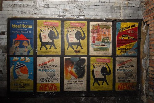 Old posters in disused passageway at Notting Hill Gate tube station, London, 2010 by mikeyashworth.
