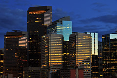 Evening Skyscrapers (Witty nickname) Tags: longexposure sunset calgary glass architecture buildings reflections evening twilight downtown skyscrapers bluesky nikkor sunlife fifthavenueplace gamewinner suncor tcpl nikond90 yourock1st eveningskyscrapers