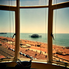west pier revisited (microabi) Tags: sea west beach window glass court pier holga brighton fuji superia front embassy pebble frame