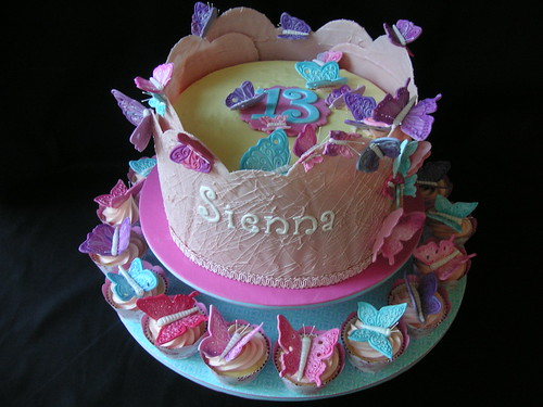 Butterfly birthday cake with cupcakes