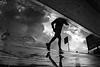 one more raining day.. #10 (Donato Buccella / sibemolle) Tags: blackandwhite bw italy milan rain reflections milano streetphotography running explore portagenova runner puddles frontpage aftertherain pozzanghera senzatesta canon400d mg7154 rainingdays sibemolle hopethesummerisnotonlyrainydaysinmilano