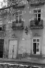 Dos Balcones (Marcia Portess-Thanks for a million+ views.) Tags: bw film monochrome architecture buildings mexico edificios morelia pentax michoacan oldbuilding