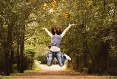 Autumn leaves (Arianna __) Tags: wood autumn colour girl leaves foglie jump joy happiness salto autunno colori luce ragazza bosco gioia 55200 saltare felicit d80 litgh