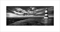 Lighthouse at Penmon Point (tkimages2011) Tags: cloudscape clouds lighthouse sky mono monochrome outdoor landscape water sea ocean beach shore ripples anglesey northwales wales