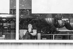 Sweet spot (RaminN) Tags: street pdx oregon portland monochrome nap chair window woman