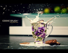 cookie splash (milk) (fotogamie) Tags: flower cup tasse fruits 50mm milk cookie cross bokeh violet lila livingroom splash f28 kekse wohnzimmer milch frchte obst stiefmtterchen glastisch blueribbonwinner coth abigfave flowercup canoneos40d goldstaraward cookiesplash my12best2009