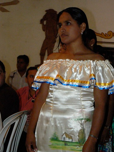 A woman dressed in traditional attire, waiting to perform.