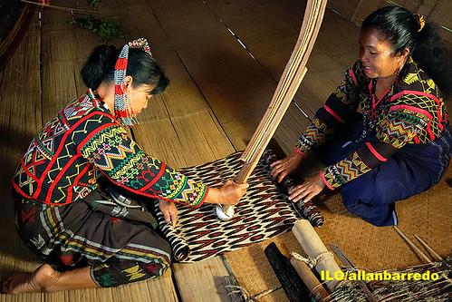 Polishing the T'nalak cloth
