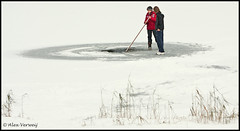 Making a hole in Mother Earth... (Alex Verweij) Tags: snow playing ice water kids danger canon hole earth sneeuw flevoland almere ijs wak 40d filmwijk alexverweij