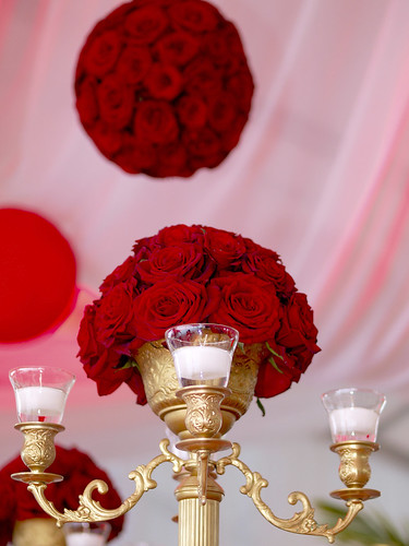 From the opulent floral centerpieces of luscious red roses on gold