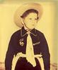 Hop-a-long Cassidy_tatteredandlost (tatteredandlostphotographs) Tags: cowboy 1950s cowboyhat buckaroo hopalongcassidy toyguns vintagephotograph vernacularphotography littlecowboy