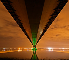 Under the Humber Bridge (Craig Hannah) Tags: longexposure bridge light orange green night reflections river dark lights shadows yorkshire barton hull span humberbridge humber bartononhumber lightpolloution
