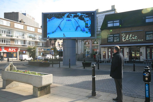 Dover's Olympic TV screen attracts crowds for the snowboarding coverage.