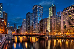 Chicago loop over the Chicago River at night (Mister Joe) Tags: street city longexposure bridge winter urban panorama chicago reflection clock colors vertical night skyscraper buildings river lights town illinois nikon downtown crossing loop chitown joe chi lasalle glowing chicagoloop chicagoriver hdr twinkling downtownchicago combined photomatix tonemapped d80 loopatnight theoriginalgoldseal