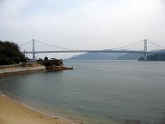 2503 First Bridge (mari-ten) Tags: bridge sea mountain beach nature japan cycling sand hiroshima shore 日本 2008 onomichi setoinlandsea eastasia 瀬戸内海 shimanami しまなみ海道 向島 広島県 青春18きっぷ 尾道市 200804 因島大橋 20080402 innoshimabridge seishun18travel mukaiisland