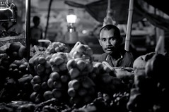 evening at tamu putatan. (1davidstella) Tags: portrait blackandwhite man night dark nikon shadows market 85mm onions kotakinabalu lamps bazaar nikkor dim sabah hawker tamu d300 putatan kerosenelamps 1davidstella