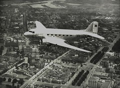"ANA DC-3 ""Kurana"" VH-UZK over Melbourne, c. 1940s, by unknown photographer (State Library of New South Wales collection) Tags: plane airplane ana aircraft aviation melbourne dac dc3 dakota raaf airliner airliners gooneybird a302 douglasdc3 royalaustralianairforce douglasdakota dc3232 douglasaircraft douglasaircraftcompany kurana australiannationalairways vhuzk wrightcycloner1820 douglasdc3232 notpwr1830twinwasp"