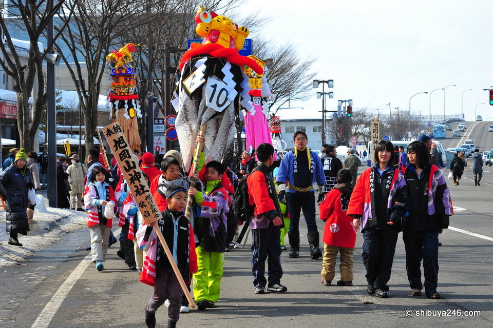 Local children get to march down the street with their exhibit.