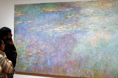 Observing Water Lilies (ralph and jenny) Tags: nyc newyorkcity newyork art museum painting fineart moma waterlilies impressionism impressionist oilpainting claudemonet themuseumofmodernart museumvisitors frenchimpressionism af35mmf2d nikond90 museumvisitor frenchimpressionist