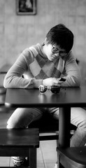 (DN Photography) Tags: boy blackandwhite bw love sunglasses table 50mm glasses chairs 14 texting d300