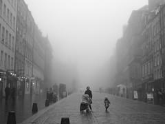 misty Edinburgh - Royal Mile (byronv2) Tags: edinburgh scotland oldtown misty fog blackandwhite blackwhite monochrome royalmile mist haar cobbles cobbledroad edimbourg woman child kid pram pushchair street candid weather architecture building history