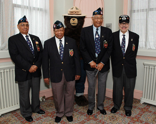 Former members of the 555th Parachute Infantry Regiment Smoke Jumpers, L to R Sergeant Clarence H. Beavers, National Triple Nickles Association President Joe Murchison, Smokey Bear, First Sergeant Walter Morris and Lt. Col Roger S. Walden. The Smoke Jumpers visited the U. S. Forest Service in Washington, D. C., on March 26, 2010.