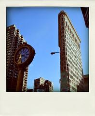 (begoña ml.) Tags: city nyc newyork buildings polaroid manhattan ciudad tamron flatiron semanasanta 2010 tiempo eeuu relojes nikond60