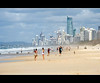 city beach II (Pawel Papis Photography) Tags: ocean life trees girls sea people dog white playing seascape building tree beach dogs water buildings relax sand raw afternoon wind wave australia queensland goldcoast sigma18200 canon400d