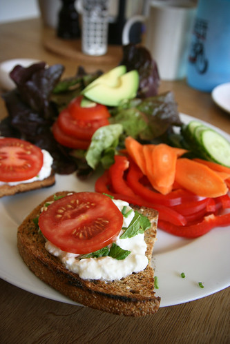 Cottage cheese and tomato on toast with mint and chives.