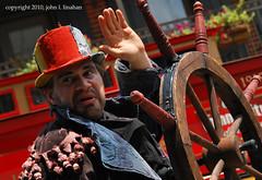 FIL 2010 XII (Jobe Roco) Tags: nikon louisiana downtown lafayette fil streetscene event performers 2010 stiltwalkers d60 2934 festivalinternationaldelouisiane cirquedelarue bateaukracboom
