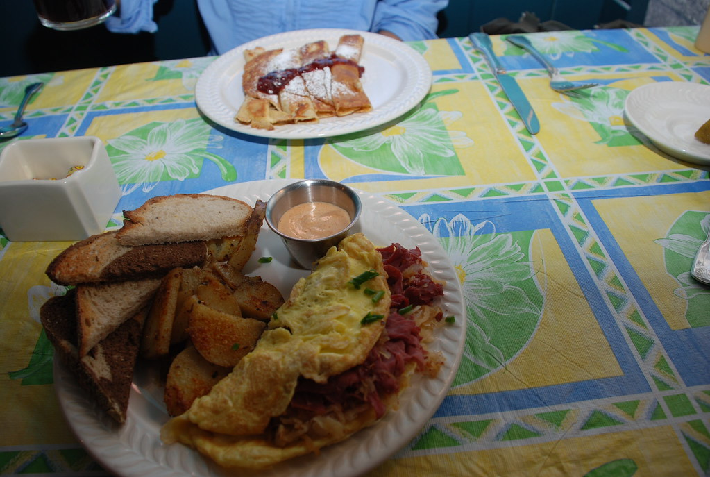 Keryn's swedish pancakes with lingonberries and my reuben omelette (corned beef, swiss, kraut) with rye and potatoes with sauce