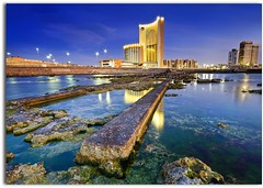 Tripoli Breakwater (blue fin art) Tags: africa city longexposure blue sea seascape rock night canon lights hotel cityscape dusk filter lee libya tripoli lybia libyan  corinthia tonemapped