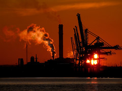 Industrial sunset (facetmorski) Tags: sunset red port industrial cranes container btc gdynia ec3 pomorskie