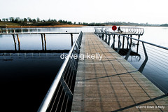 Thinking Things Over (Dave G Kelly) Tags: ireland red man water river vanishingpoint alone sitting loneliness shannon boardwalk solitary lifebuoy railings stilts lightroom leitrim leadinglines rivershannon canoneos5d coleitrim davegkelly copyright2010davegkelly gettyimagesirelandq1