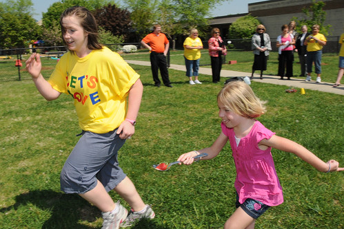 "Physical Education Teacher Mandy Davis runs with a Thomasville Primary School student in the ""strawberry in a spoon race"" as part of their Let's Move program inspired by First Lady Michelle Obama. The school received a USDA HealthierUS School Challenge Gold Award. (USDA photo by Debbie Haston-Hilger)"
