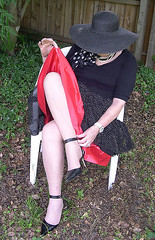 Me, flashing my red petticoat and adjusting my shoes. (Sugarbarre2) Tags: show light shadow party people urban woman baby sun white black hot green hat garden dark mom outdoors shoes flash s skirt babe short wife upskirt satin granny