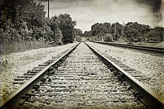 journey back home (SouthernHippie) Tags: road county old travel bw texture train vintage dark grit al rocks moody south alabama railway trains forgotten future lonely cart somber traintrack gravel chilton clanton antiqued daysgoneby railcart