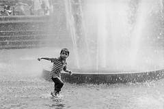 children in washington square fountain (cappuccetto nero) Tags: bw usa baby ny newyork film water fountain america 35mm children square fun blackwhite washington play manhattan games washingtonsquare bigapple bianconero analogic grandemela blackwhiteaward analogicusa
