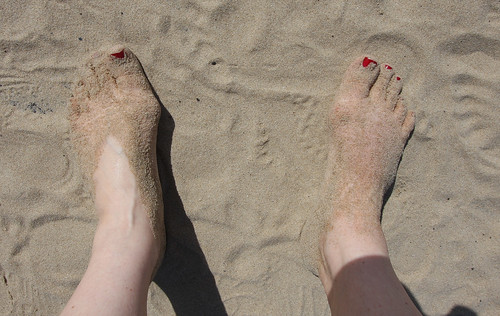 Füße im Touristensand