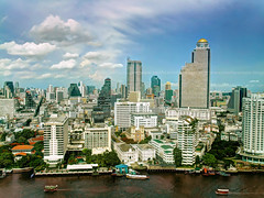 Bird's Eye View of Bangkok (I Prahin | www.southeastasia-images.com) Tags: road city sky panorama colors sunshine skyline architecture clouds skyscraper buildings river thailand boats hotel riverside bangkok business angels thai dome metropolis cbd hotels oriental hdr birdseye orientalhotel mandarinoriental chaophrayariver statetower sathorn thedome goldendome assumptioncollege assumptioncathedral shangrilahotel tonemap