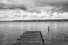 Bay at Rice's Point, Duluth (Sharon Mollerus) Tags: bw blackwhite bongbridge clouds dock industrial stormy duluth minnesota unitedstates us cfpti17