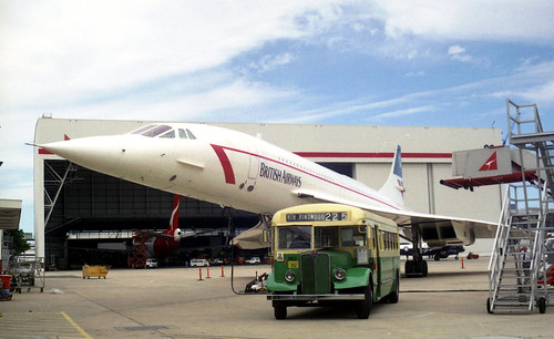 British Airways Concorde Jet (Registration G-BOAD) and Sydney Bus Museum AEC Regal III 352 at Sydney Airport, New South Wales, Australia.