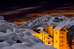 Winter Night in Foppolo (Pierpaolo.) Tags: longexposure november autumn trees houses red sky italy panorama moon mountain snow mountains alps cold fall tourism nature colors beautiful alberi night clouds montagne stars landscape lights evening italian europa europe italia nuvole novembre quiet village view natural magic natura panoramic case luna cielo neve vista moonlight luci palazzo turismo autunno rosso colori alpi bergamo montagna calma lombardia 2009 freddo notte sera magico stelle lombardy paese bellissimo escursione tranquillit canoneos30d manfrotto190xprobtripod vallebrembana manfrotto486rc2head prealpiorobie sigma18501850mm28f28exdc