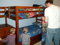 Alex and Zach watch as Daddy finishes the beds