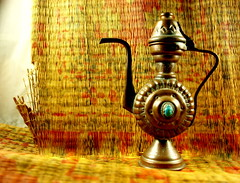 Strange how a teapot can represent at the same time the comforts of solitude and the pleasures of company (Clever Poet) Tags: old sun rising symbol tea mat copper teapot tao scarab beebes teapotscarab