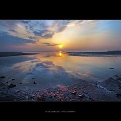 cloudy mirror [hdr] (alvin lamucho ©) Tags: ocean longexposure blue light sea sun seascape reflection colors clouds sunrise canon mirror raw cloudy horizon middleeast wideangle kuwait hdr risingsun 1022 tif uwa fintas egailabeach rebelt1i