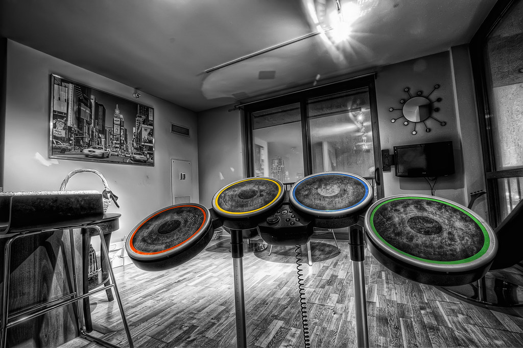 A wide-angle view of the Rock Band drum set in HDR with selective color application.