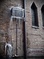 too good at it's job (sebboh) Tags: winter chicago brick church window noparking 28mm olympus airconditioner hydepark f2 gutter vivitar icicles closefocus e520