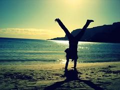 Now My Feet Won't Touch The Ground (Ai in Technicolor) Tags: sea summer sun art beach hope fly friend mare shadows estate dream ombre crossprocessing spiaggia silouhette sunnyday ruota sogno volare ginnastica piediinaria