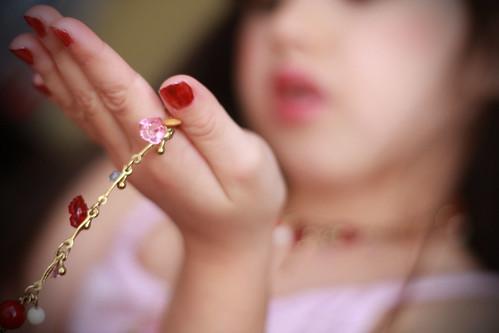.admiring mama's jewelery.